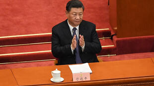 Xu Zhangrun had criticised the 2018 abolition of presidential term limits, which left Xi Jinping (pictured) free to rule for life