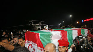 People carry the casket of Iranian commander Qasem Soleimani upon arrival at Ahvaz International Airport in Tehran on January 5, 2020
