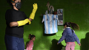 Diego Maradona's autographed shirt is displayed at a community eatery in Buenos Aires