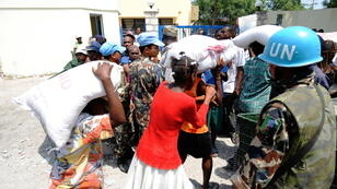 A UN peacekeeper guards a food distribution point in Port-au-Prince in March 2010.