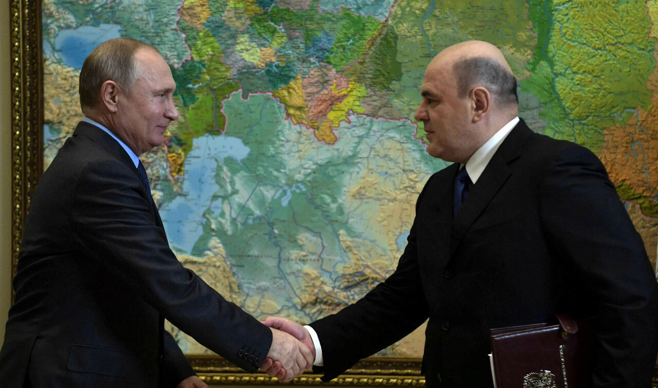 Vladimir Putin and Russian tax chief Mikhail Mishustin, nominated prime minister on January 15, 2020, photographed here in Sochi, Russia, November 20, 2018.