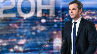 French Health Minister Olivier Véran sits on the studio set of French television channel TF1's evening news before an interview on January 21, 2021, in Boulogne Billancourt, on the outskirts of Paris.