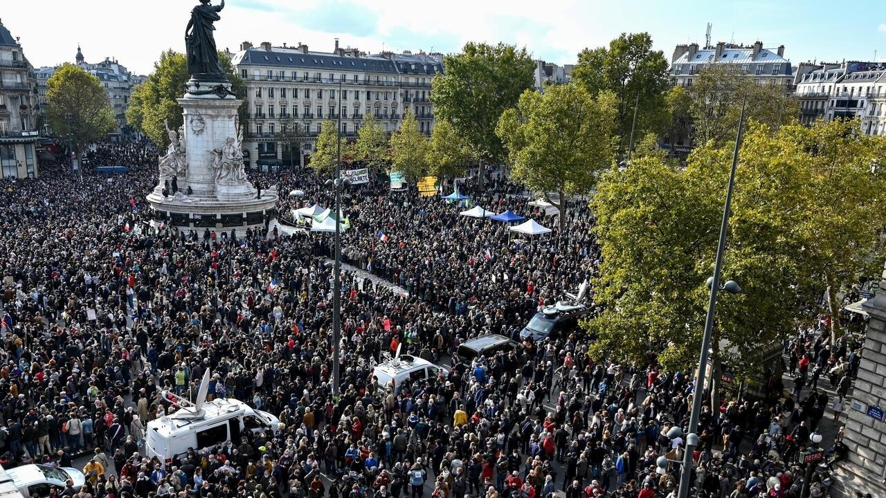 Thousands gather in Paris to pay respects to murdered teacher