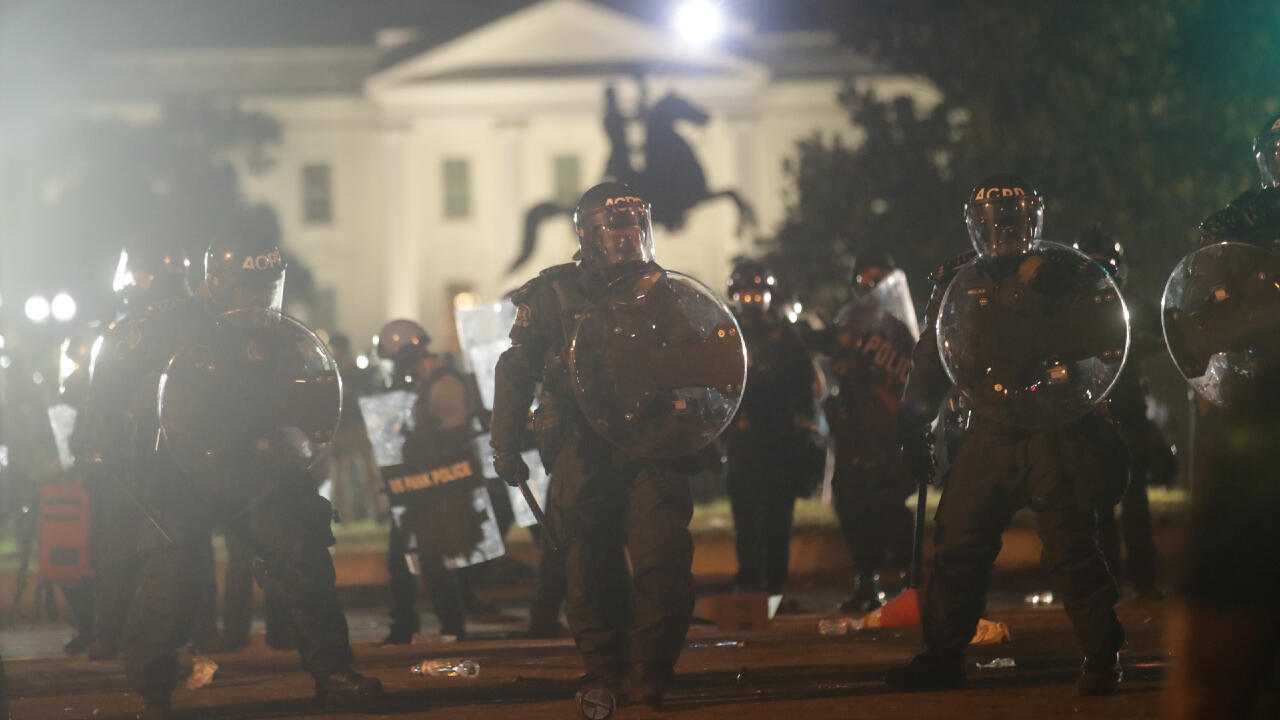 Law enforcement personnel clash with protesters rallying at the White House against the death in Minneapolis police custody of George Floyd, in Washington, D.C., USA, May 31, 2020.