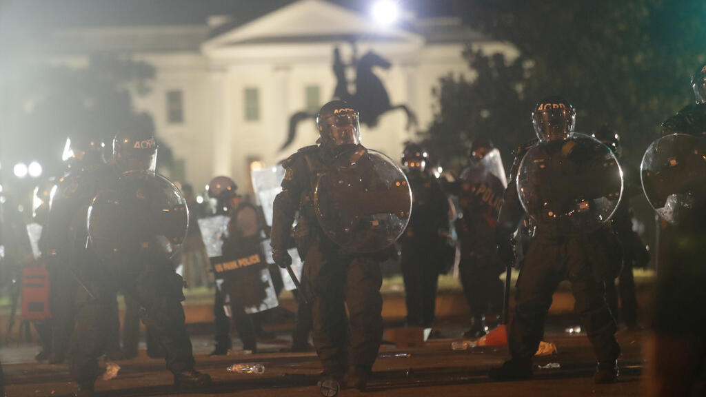 Protesters and police clash in front of White House as curfews declared in major US cities