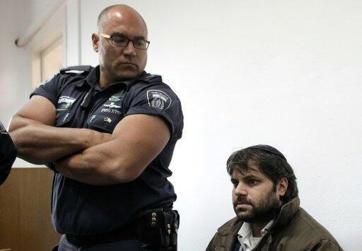 يوسف حاييم بن ديفيد (يمين) في المحكمة في القدس في 20 ديسمبر 2015