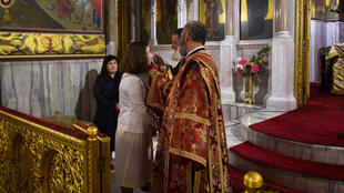Greek Orthodox churches opened up for the first time in two months with priests giving communion to those who wanted it