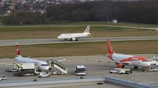 Air France, Swiss and EasyJet airlines aircraft are pictured at Cointrin Airport in Geneva, Switzerland on March 13, 2020.