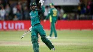 Victory salute: Mohammad Hafeez celebrates victory