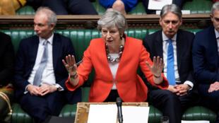 La primera ministra británica, Theresa May, habla en el Parlamento en Londres el 12 de marzo de 2019.