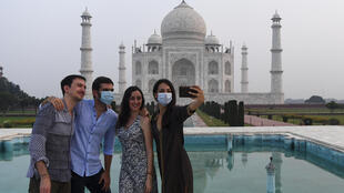 Tourists have their pictures taken at the Taj Mahal in Agra on September 21, 2020.