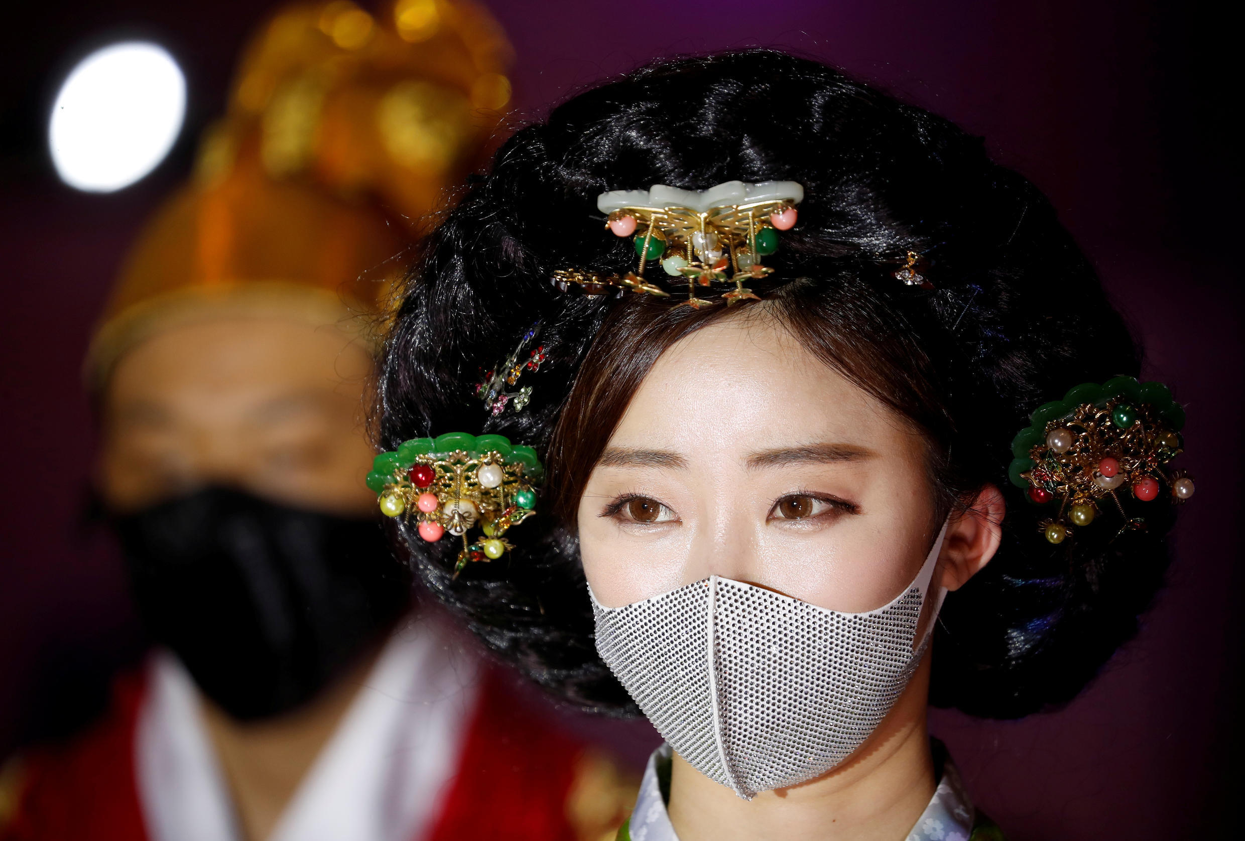 Models present creations during a fashion show, wearing masks as a measure to avoid the spread of the coronavirus disease (Covid-19), in Seoul, South Korea July 24, 2020.