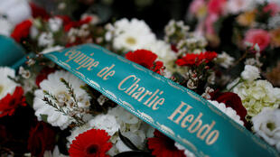 Flowers are seen outside the satirical newspaper Charlie Hebdo's former office on the fifth anniversary of the attack and a siege at a Kosher supermarket that killed 17 people in Paris, France on January 7, 2020.