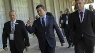 Justice Minister Sergio Moro (center) was the anticorruption judge who handed Lula his first conviction in 2017, which prevented him from running in a presidential election he was widely expected to win