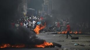 Demonstrators set tire barricades ablaze on the fourth day of protests in Port-au-Prince demanding the resignation of Haitian President Jovenel Moise