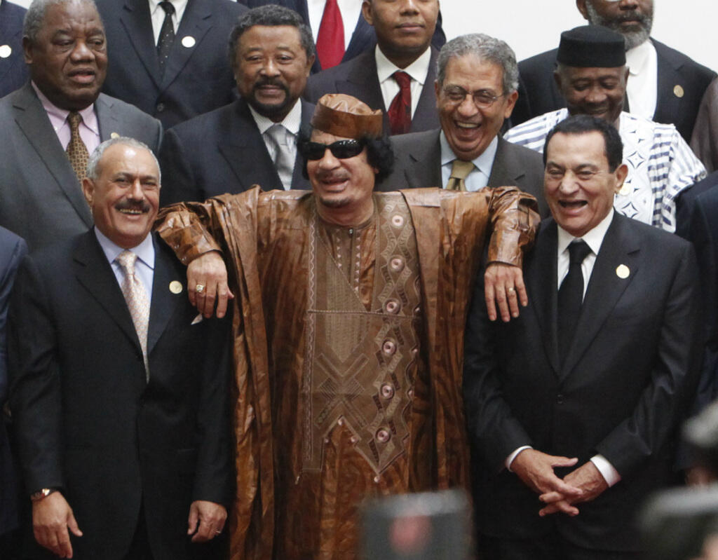 Libyan leader Muammar Gaddafi rests his arms on the shoulders of Egyptian President Hosni Mubarak, right, and Yemeni President Ali Abdullah Saleh in October 2010. A few months later, all three leaders were removed from power.