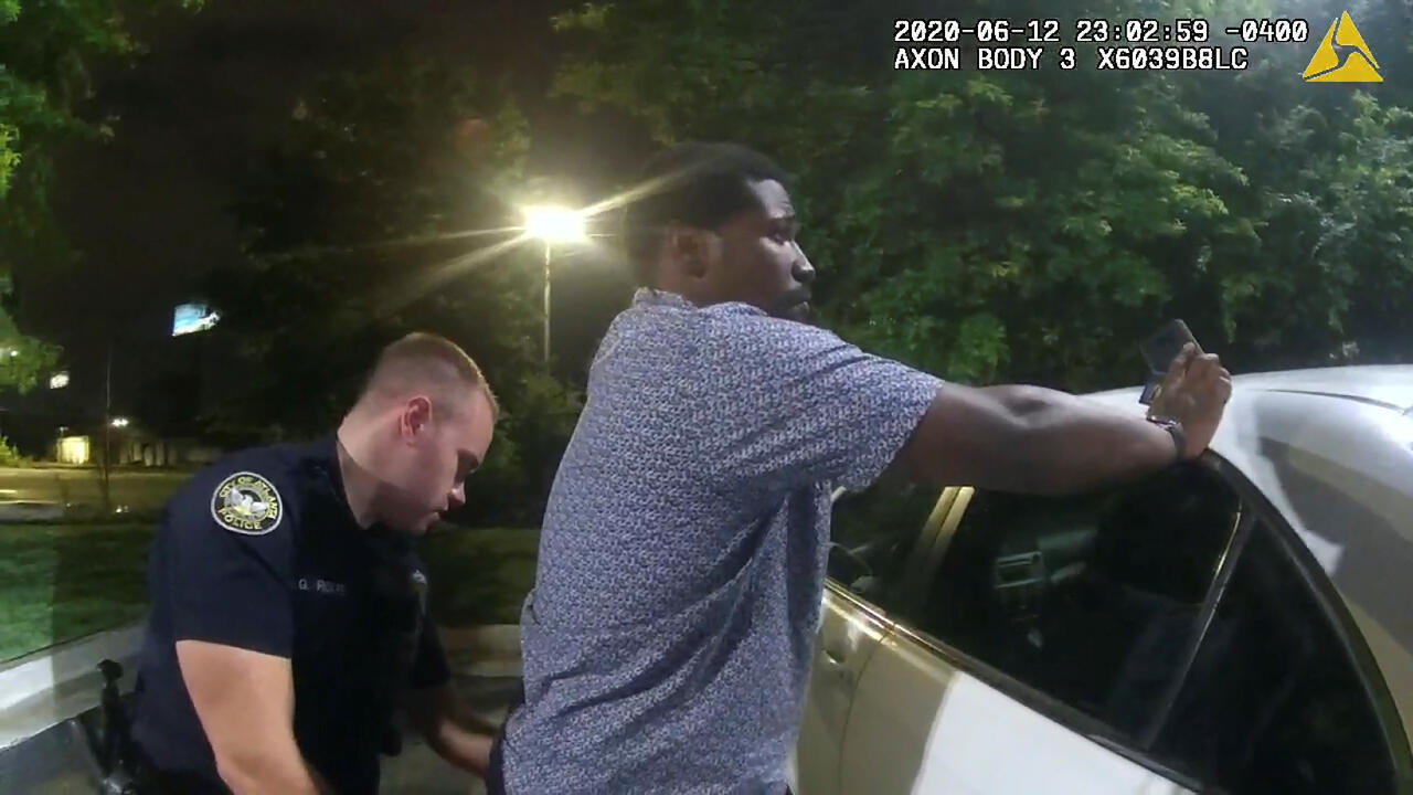 Former Atlanta Police Department officer Garrett Rolfe searches 27-year-old Rayshard Brooks in a Wendy's restaurant parking lot in a still image from the video body camera of officer Devin Bronsan in Atlanta, Georgia, U.S. June 12, 2020. Video taken June 12, 2020.