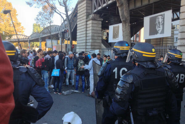 Riot police clash with migrants and protestors near Metro Jaures