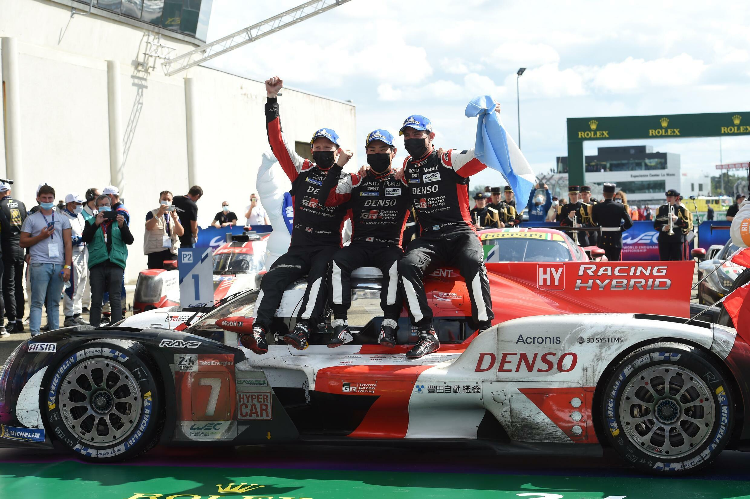 Endurance men: Toyota drivers Mike Conway, Kamui Kobayashi and Jose Maria Lopez celebrate their victory at Le Mans