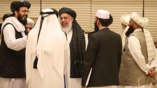 Des membres de la délégation afghane lors du second jour de la rencontre entre Taliban et responsables afghans, le 8 juillet 2019, à Doha, au Qatar.