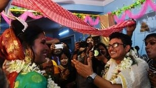Indian transgender woman Tista Das (L), 38, and transgender man Dipan Chakravarthy, 40, perform the rituals of a traditional Hindu marriage ceremony, pledging their love for each other before family and friends, in Kolkata