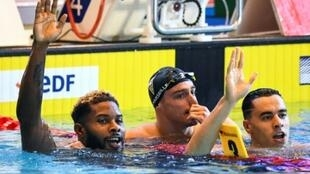 Winner French swimmer Mehdy Metella (L), second-placed French swimmer Clement Mignon (C) and off competition third-placed Algerian swimmer Oussama Sahnoune (R) reacts after the men's 100m freestyle final during the French swimming championships in Rennes, western France, on April 19, 2019.