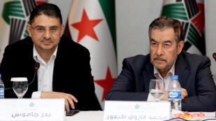Le secrétaire général de la CNS Badr Jamus et Mohamed Farouk Tayfur