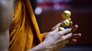 Older Thais venerate the supposed protective powers of the 'Golden Son' dolls