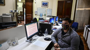 Thomas Casavieja pictured at a branch of Argentina's Banco Nacion in Buenos Aires where he works, in September 2020