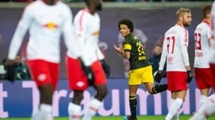 Belgium midfielder Axel Witsel celebrates scoring the winner in Borussia Dortmund's 1-0 victory at RB Leipzig which left them six points clear at the top of the Bundesliga table ahead of defending champions Bayern Munich