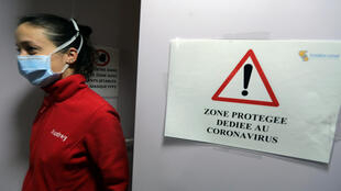 "File photo shows sign reading ""Protected area dedicated to coronavirus"" at a hospital in Nice, France."