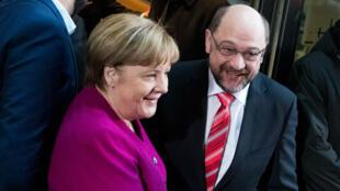 المستشارة الألمانية أنغيلا ميركل وزعيم الحزب الاشتراكي مارتن شولتز