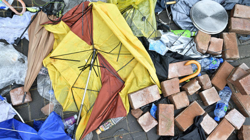 Anthony Wallace, AFP | Bricks and debris have been left scattered by the Hong Kong government headquarters after protesters tried to storm the building