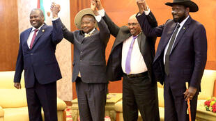 Mohamed Nureldin Abdallah, REUTERS | Sudan's President Omar Al-Bashir hold hands with Uganda's President Yoweri Museveni, South Sudan's President Salva Kiir and South Sudan rebel leader Riek Machar during a South Sudan peace meeting in Sudan June 25, 2018.