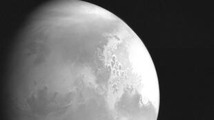 The first image of Mars taken by China's Tianwen-1 unmanned probe is seen in this handout image released by China National Space Administration (CNSA) February 5, 2021.