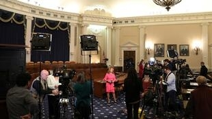 Television news crews set up for live reports ahead of Trump impeachment inquiry.