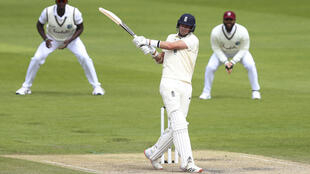 Hitting out - England's Stuart Broad frustrated the West Indies on the second day of the third Test at Old Trafford on Saturday