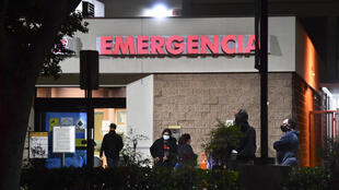 People wait outside the emergency room of the Garfield Medical Center in Monterey Park, California on December 1, 2020.