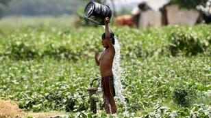 An Indian boy tries to cool off by dousing himself with water in New Delhi on May 29, 2019 during a heatwave