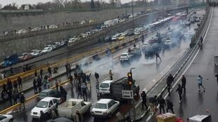 People protest against increased petrol prices on a motorway in Tehran on November 16, 2019.