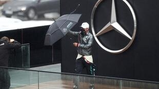 Valtteri Bottas posed with an umbrella as rain prevent practice at the Nurburgring