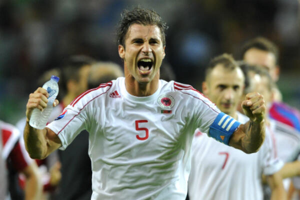 Talismanic captain Lorik Cana celebrates Albanai's historic qualification for Euro 2016.