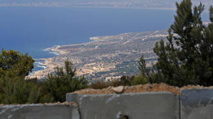 The picture taken on September 5, 2018 near Israel's Rosh Hanikra border crossing with Lebanon shows the Naqoura border town in southern Lebanon where Lebanese and Israeli delegates are to hold UN-mediated talks on their disputed border