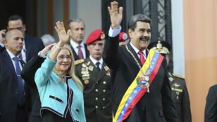 Le président vénézuélien Nicolas Maduro et son épouse, Cilia Flores, lors d'une commémoration au Panthéon national à Caracas, le 7 août 2019.