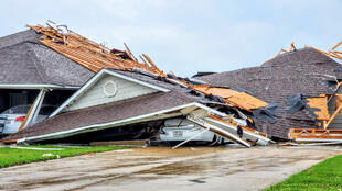 Damaged buildings and vehicles are seen in the aftermath of a tornado in Monroe, Louisiana, U.S. April 12, 2020, in this still image obtained from social media.