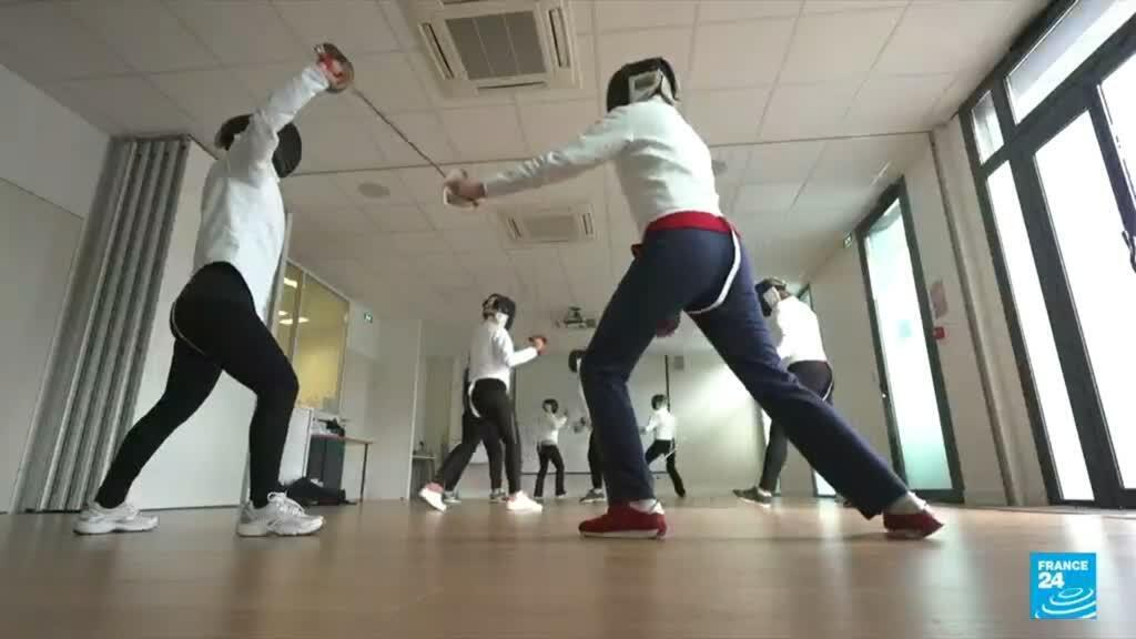 A group of female fencers battle their breast cancer at a sports centre in Lyon.