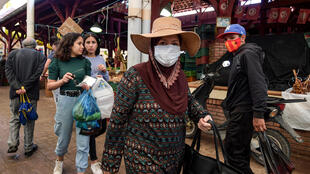 Shoppers browse through the central market in Tunis during the fasting month of Ramadan