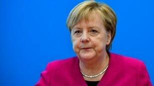 Merkel, a trained scientist, was raised behind the Iron Curtain