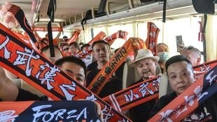 Wuhan Zall fans in jubilant mood on a bus in Suzhou ahead of Sunday's match against Beijing Guoan in the Chinese Super League. It is the first match they have been allowed to attend since the coronavirus outbreak