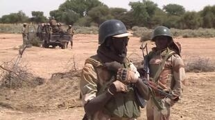 Nigerian soldiers on patrol along the border between Nigeria and Mali.